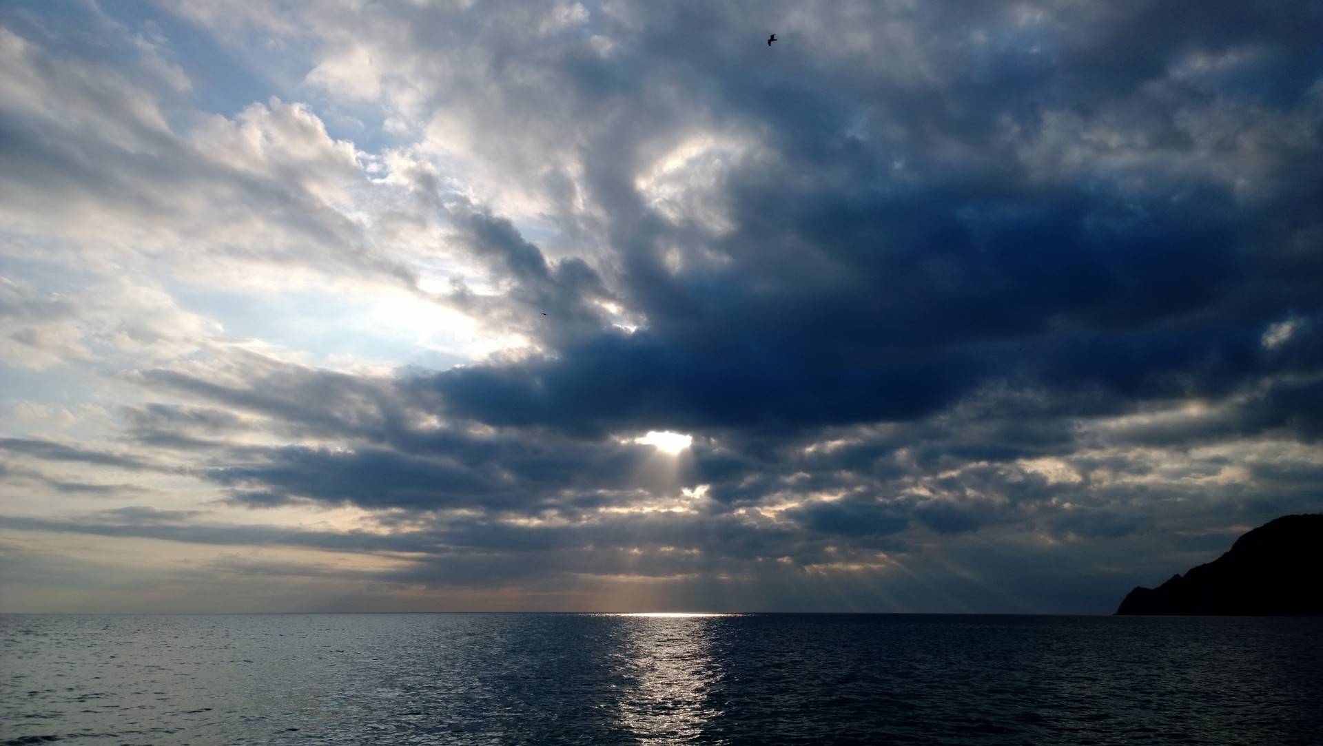 god like scenery, clouds covering the sun and a big lake