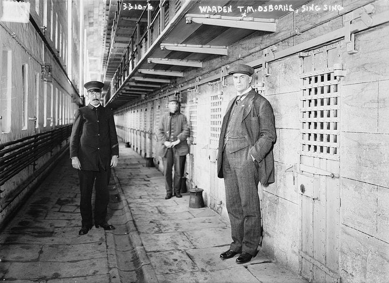 Gregarious Troglodyte prison picture black and white with guards and warden