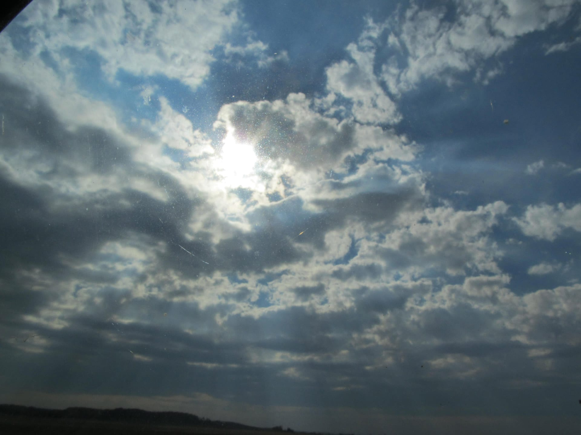 a picture of the sun shinning through clouds make one ask how we know god exists