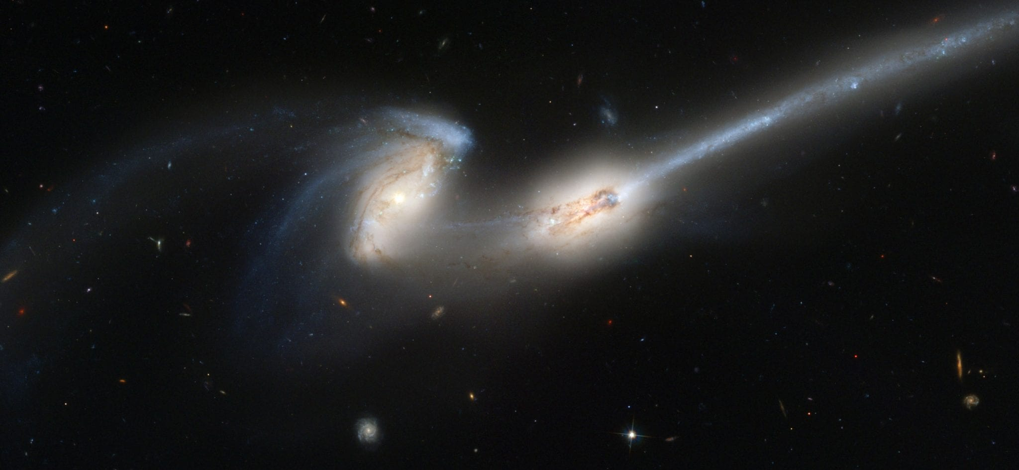 a picture of 2 universes in the vastness or dark space