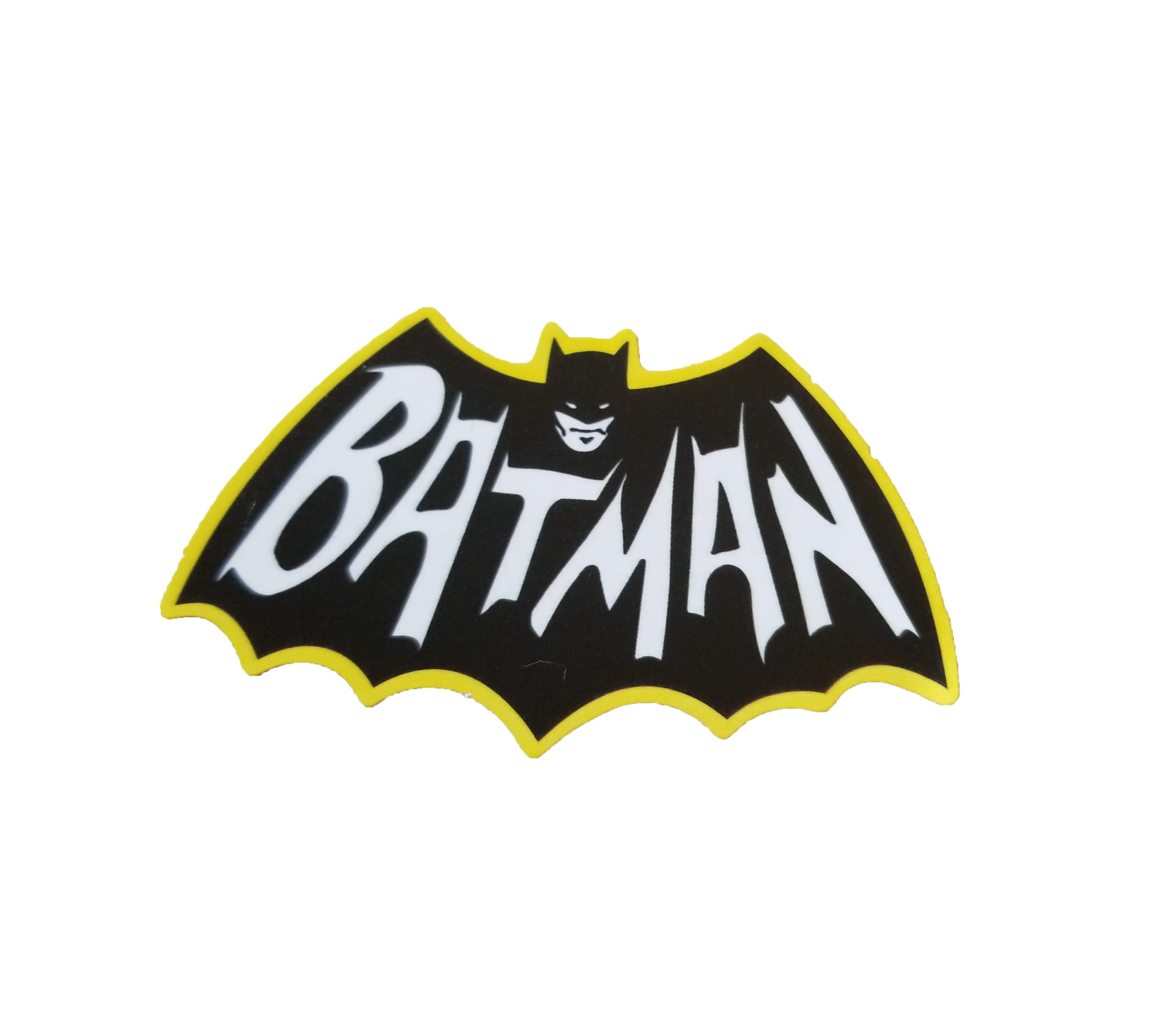 "Adam West Batman logo with a bat looking design with ""Batman"" written across the wing span and a Batman face where the head is"